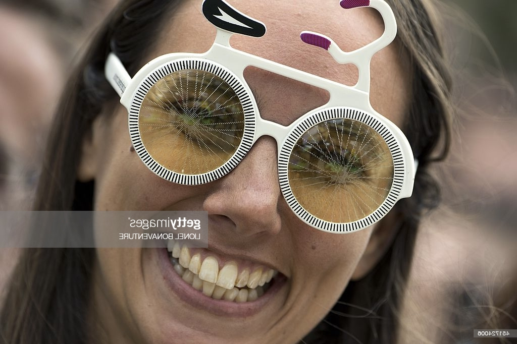 A woman wears glasses shaped like a bike at the departure village before the start of the 190.5 km first stage of the 101st edition of the Tour de France cycling race on July 5, 2014 between Leeds and Harrogate, northern England. The 2014 Tour de France gets underway on July 5 in the streets of Leeds and ends on July 27 down the Champs-Elysees in Paris.   AFP PHOTO / LIONEL BONAVENTURE        (Photo credit should read LIONEL BONAVENTURE/AFP via Getty Images)