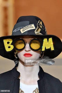 MILAN, ITALY - FEBRUARY 25: A model walks the runway at the Dolce & Gabbana Ready to Wear Fall/Winter 2018-2019 fashion show during Milan Fashion Week Fall/Winter 2018/19 on February 25, 2018 in Milan, Italy. (Photo by Victor VIRGILE/Gamma-Rapho via Getty Images)